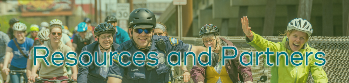 "Text ""Resources and Partners"" header - over image of police officer biking leading group on bike path"